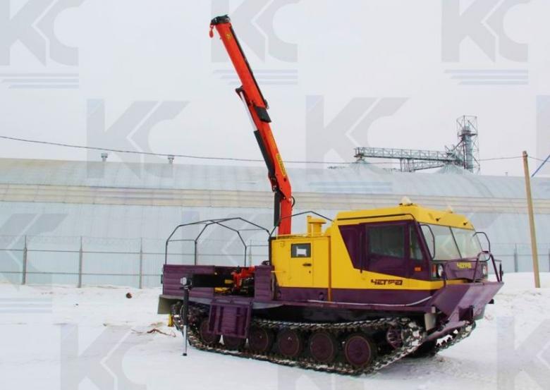 Гусеничная транспортная машина ТМ-140 с крано-манипуляторной установкой «Palfinger PK 8500 Performance»