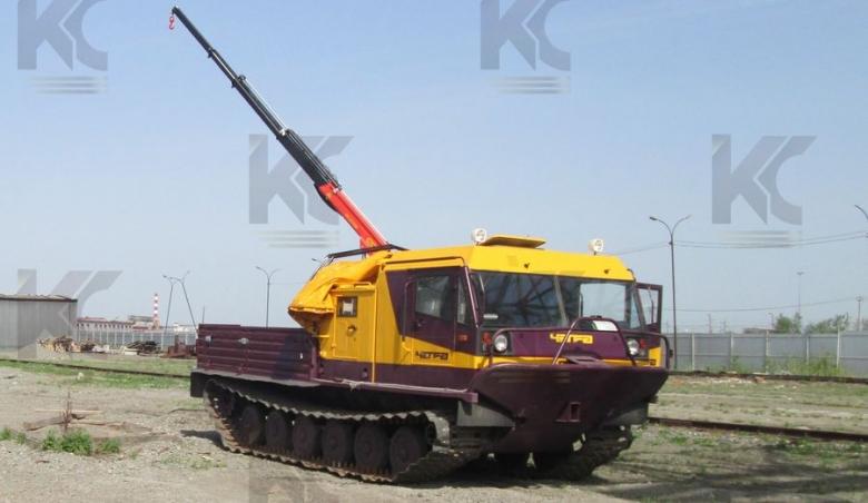 Гусеничная транспортная машина ТМ-140 с крано-манипуляторной установкой «Palfinger PC 2700»